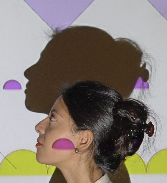 Artist_Ana_Roldán_in_Madrid_in_front_of_her_projection_1.jpg